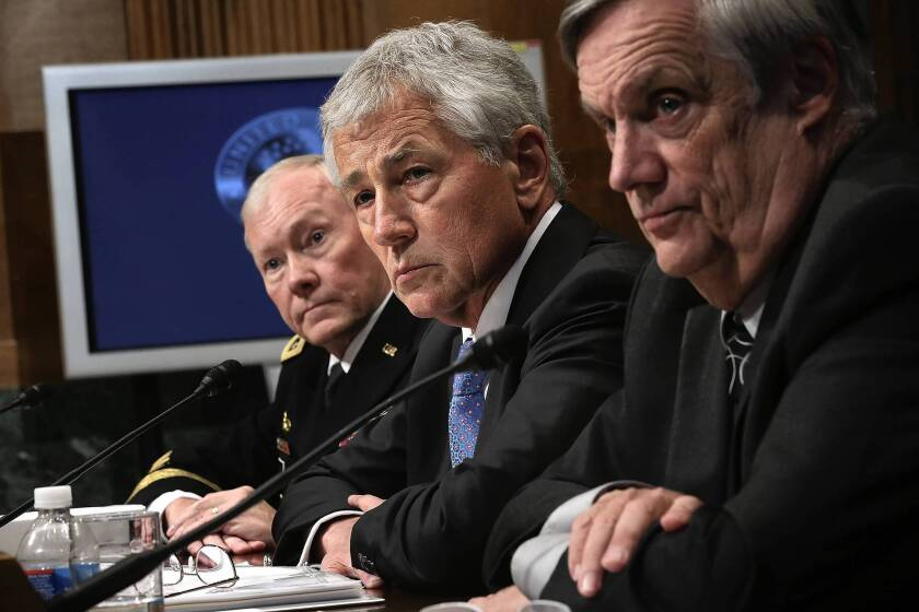 Gen. Martin Dempsey, chairman of the Joint Chiefs of Staff; Defense Secretary Chuck Hagel; and Undersecretary of Defense Robert Hale, from left, testify before the Senate in June.