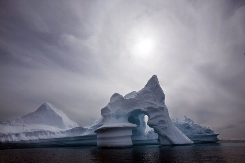 FILE - In this July 19, 2007 file photo an iceberg melts off Ammassalik Island in Eastern Greenland. Scientists who are fine-tuning a landmark U.N. report on climate change are struggling to explain why global warming appears to have slowed down in the past 15 years even as greenhouse gas emissions