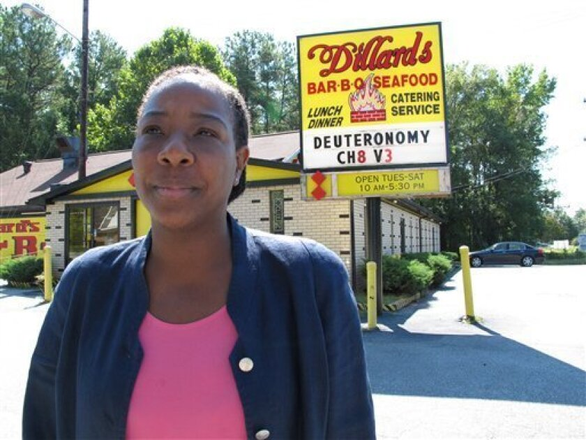 Wilma Dillard stands outside her family's barbecue restaurant in Durham, NC, on Thursday, Sept. 8, 2011. The family had to close after 58 years because of a drop in business and because banks were increasingly unwilling to lend money. (AP Photo/Allen Breed)
