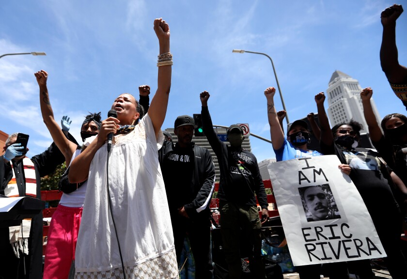 Melina Abdullah, co-founder of Black Lives Matter Los Angeles, raises a fist during a memorial and protest for George Floyd