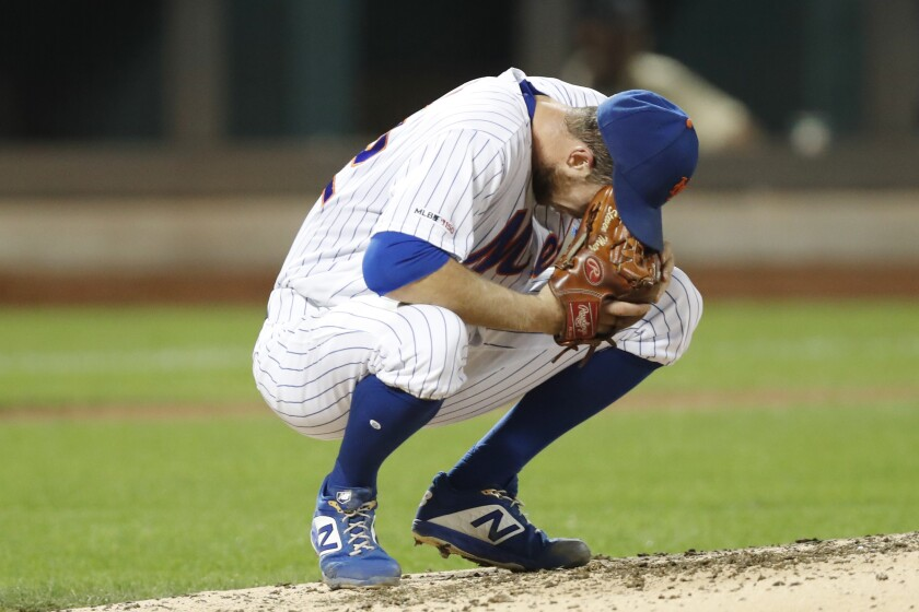 New York Mets starting pitcher Steven Matz crouches on the mound after allowing a sixth-inning grand slam to Miami Marlins' Jorge Alfaro in a baseball game Monday, Sept. 23, 2019, in New York. (AP Photo/Kathy Willens)