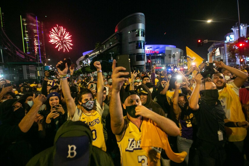 Los Angeles Lakers fans gather near Staples Center in L.A. to celebrate the Lakers NBA Finals win over the Miami Heat.