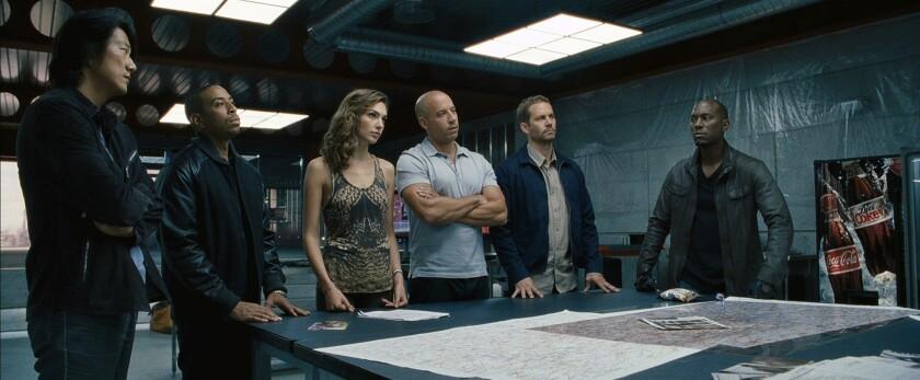"From left, Sung Kang, Chris ""Ludacris"" Bridges, Gal Gadot, Vin Diesel, Paul Walker and Tyrese Gibson in ""Fast & Furious 6."""