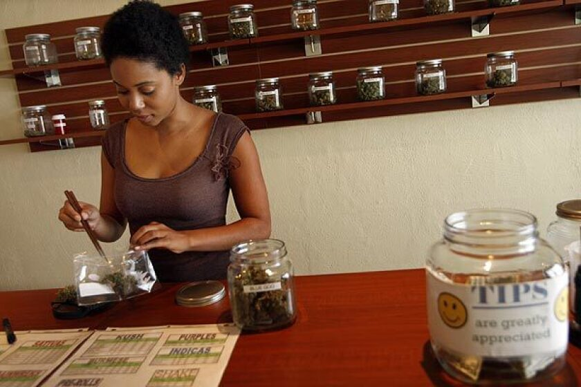 Budtender Kim prepares an order for a client at Green Oasis, a medical marijuana dispensary in Los Angeles. A Superior Court judge decided that the city of Los Angeles' moratorium on new dispensaries is invalid and granted a preliminary injunction against enforcement of the ban sought by Green Oasis, which had sued the city.