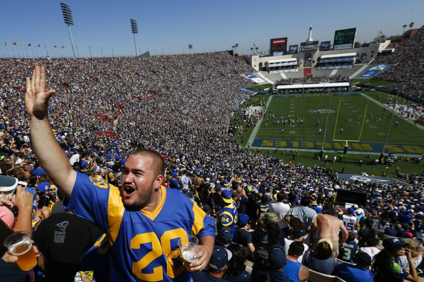 Fans cheer for the Los Angeles Rams during a 9-3 victory over the Seattle Seahawks at the Coliseum on Sept. 18, 2016.