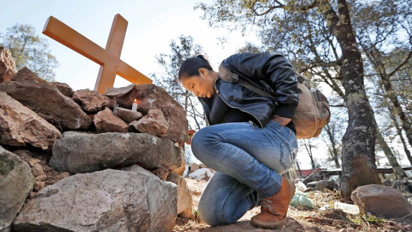 A friend of Isidro Baldenegro Lopez visits his grave site in January. Baldenegro was the fifth environmental defender killed in the last year in the community of Coloradas de la Virgen, Chihuahua, in the Golden Triangle.