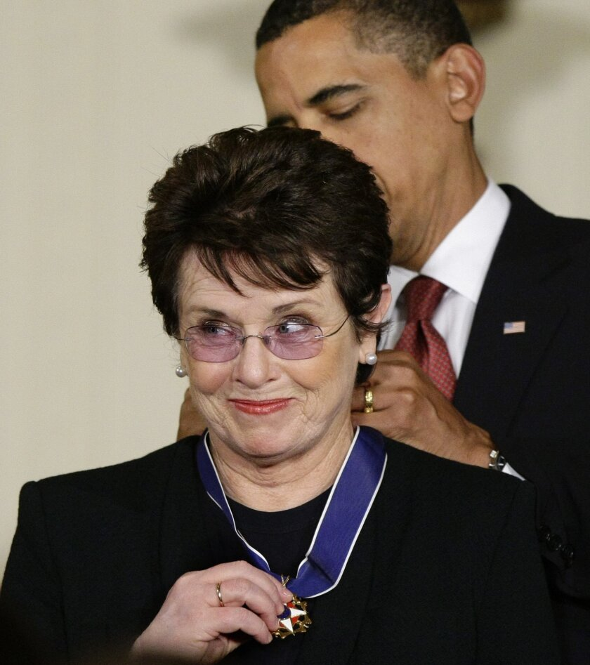 """FILE - In this Aug. 12, 2009 file photo, President Barack Obama presents the 2009 Presidential Medal of Freedom to Billie Jean King, known for winning the famous """"Battle of the Sexes"""" tennis match, and championing gender equality issues, during ceremonies at the White House in Washington. King believes standing up to discrimination is the best way to combat it. She will help lead the U.S. delegation in the opening ceremonies at the Sochi Olympics in Russia, which recently passed an anti-gay law. (AP Photo/J. Scott Applewhite, File)"""