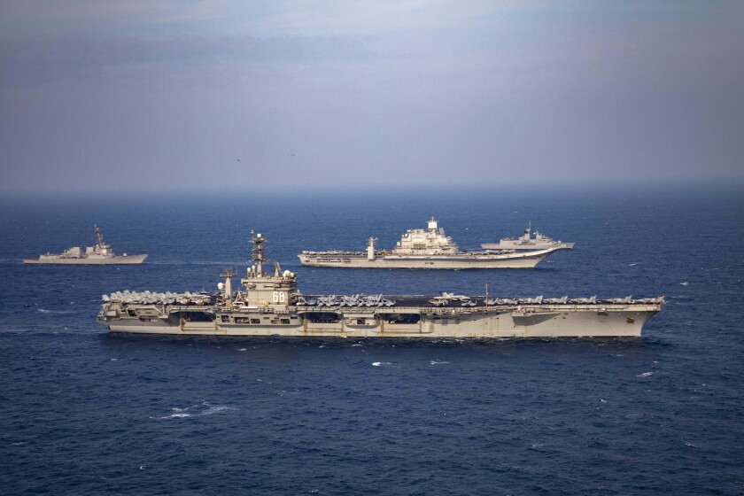 Aircraft carriers and warships participate in the second phase of Malabar naval exercise, a joint exercise comprising of India, US, Japan and Australia, in the Northern Arabian Sea on Tuesday, Nov. 17, 2020. The four countries form the Quadrilateral Security Dialogue, or the Quad. (Indian Navy via AP)