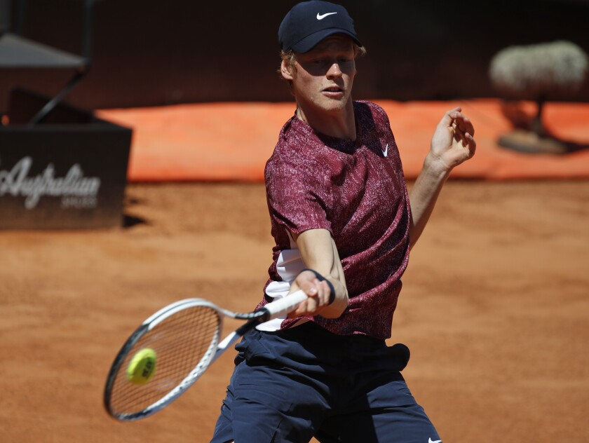 Jannik Sinner of Italy returns the ball to Ugo Humbert of France during their match at the Italian Open tennis tournament, in Rome, Monday, May 10, 2021. (AP Photo/Alessandra Tarantino)