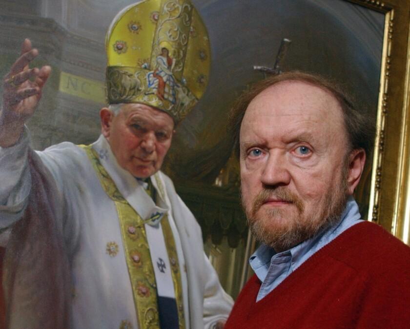 Artist Nelson Shanks poses beneath his portrait of Pope John Paul II in 2002.