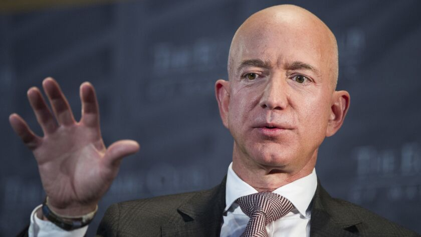 FILE- In this Sept. 13, 2018, file photo Jeff Bezos, Amazon founder and CEO, speaks at The Economic