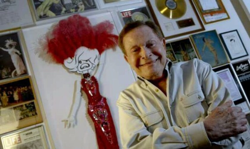 Veteran composer Jerry Herman, pictured at his Beverly Hills home in 2010, was known for his upbeat, deceptively simple lyrics and catchy tunes.