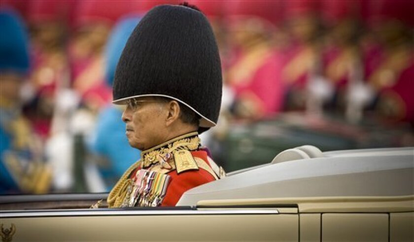 Thailand's King Bhumibol Adulyadaj reviews the Royal Guards at the Royal Plaza Tuesday, Dec. 2, 2008, in Bangkok, Thailand. King Bhumibol Adulyadaj is scheduled to make a radio speech Thursday night, Dec. 4, 2008 on the eve of his birthday and may Thais are hoping that he will offer guidance on the current political crisis. (AP Photo/David Longstreath)