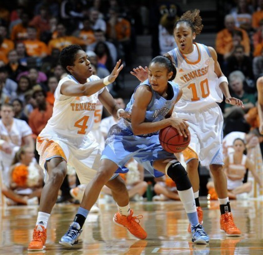 Tennessee's Kamiko Williams, left, and Meighan Simmons pressure North Carolina's Latifah Coleman during an NCAA college basketball game at Thompson-Boling Arena in Knoxville, Tenn., Sunday, Dec. 2, 2012. (AP Photo/The Knoxville News Sentinel, Amy Smotherman Burgess)