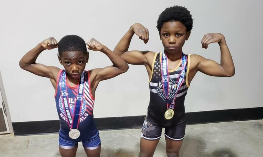 Tyrese Crawford, 6 and Terence Crawford III, 8, pose after competing in the Tulsa Nationals Kickoff wrestling tournament.