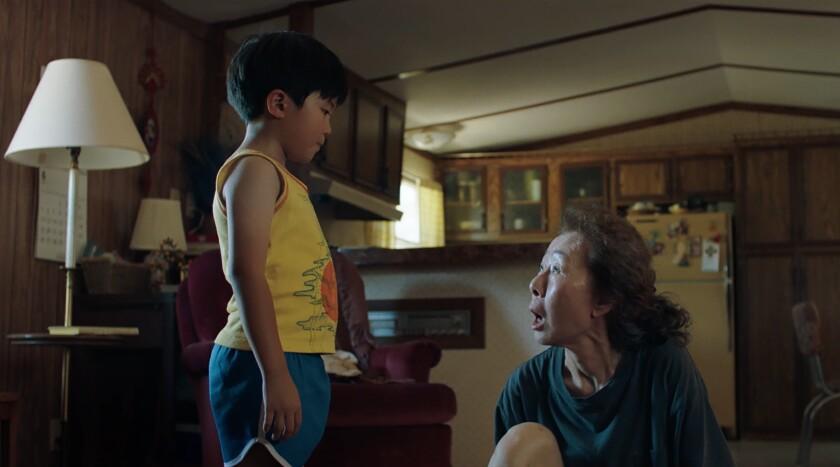 "Alan Kim talks to Yuh-Jung Youn in a scene from ""Minari."""