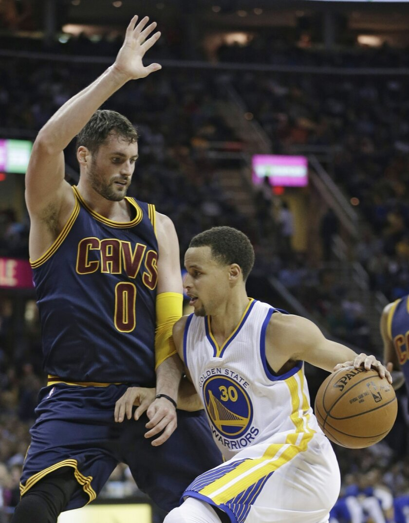 Golden State Warriors' Stephen Curry (30) drives past Cleveland Cavaliers' Kevin Love (0) during the third quarter of an NBA basketball game Thursday, Feb. 26, 2015, in Cleveland. The Cavaliers defeated the Warriors 110-99. (AP Photo/Tony Dejak)