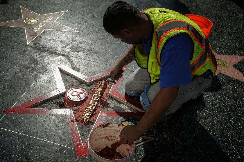 A new Donald Trump star on the Hollywood Walk of Fame is installed after it was vandalized.