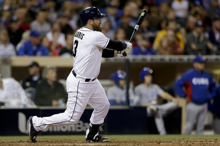 San Diego Padres' Derek Norris hits a two-run double against the Chicago Cubs during the eighth inning in a baseball game Tuesday, May 19, 2015, in San Diego. (AP Photo/Gregory Bull)