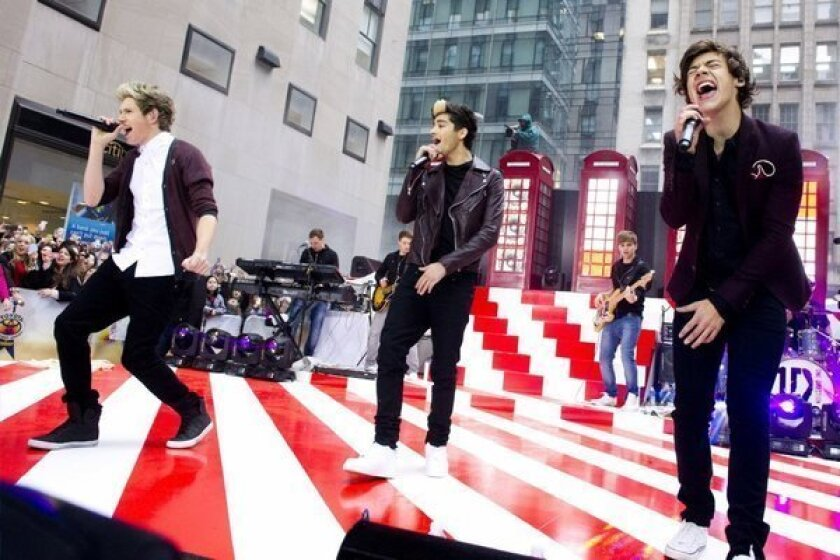 "Members of One Direction -- from left, Niall Horan, Zayn Malik and Harry Styles -- perform on NBC's ""Today"" show."
