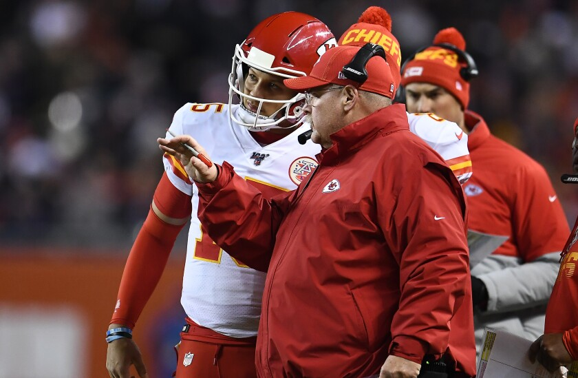 Kansas City coach Andy Reid and quarterback Patrick Mahomes talk during a timeout against Chicago at Soldier Field on Dec. 22, 2019.