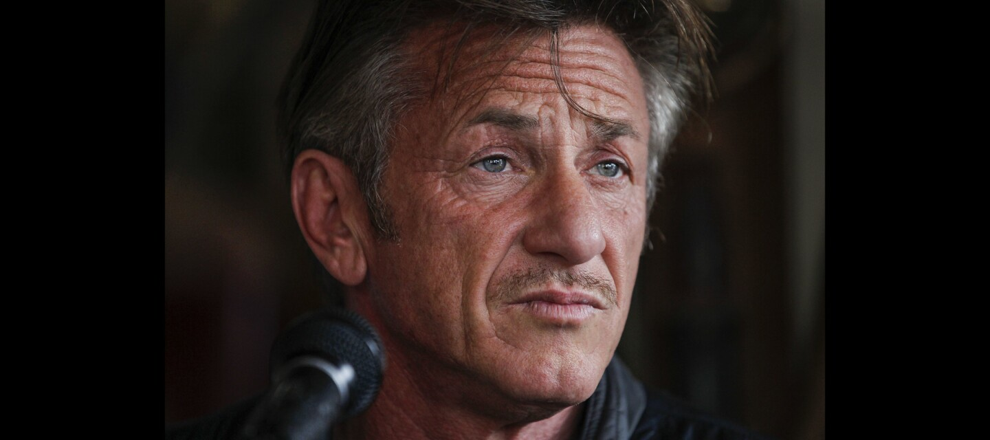 Sean Penn looks out over the crowd just before he reads from his new book 'Bob Honey Who Just Do Stuff'.