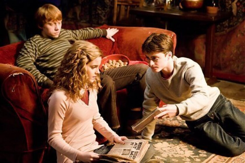 """In this image released by Warner Bros., Emma Watson, center, Daniel Radcliffe, right, and Rupert Grint are shown in a scene from """"Harry Potter and the Half-Blood Prince."""" (AP Photo/Warner Bros., Jaap Buitendjik)"""