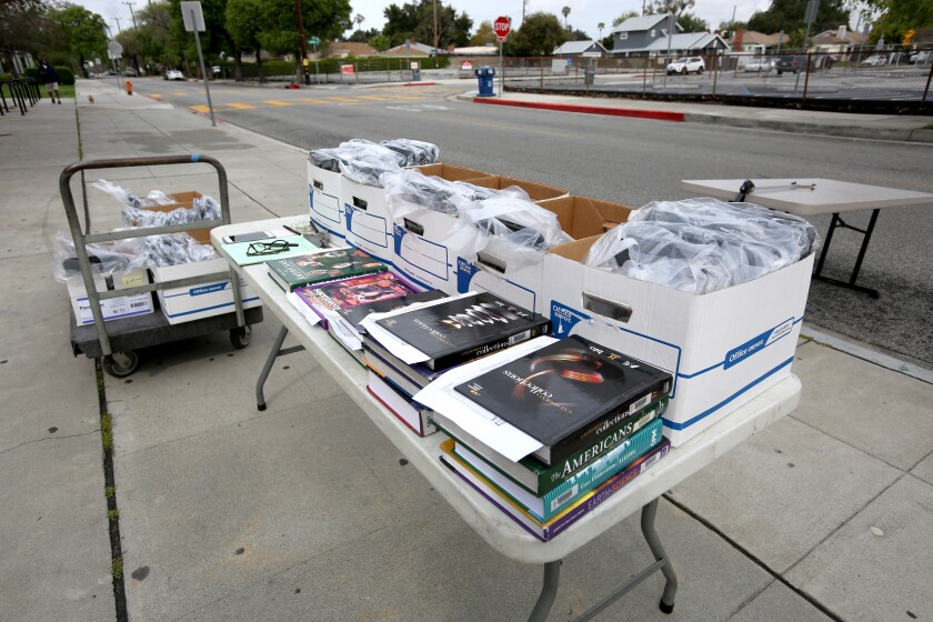 Burroughs High School passed out Chromebook laptops to students during the second distribution day.