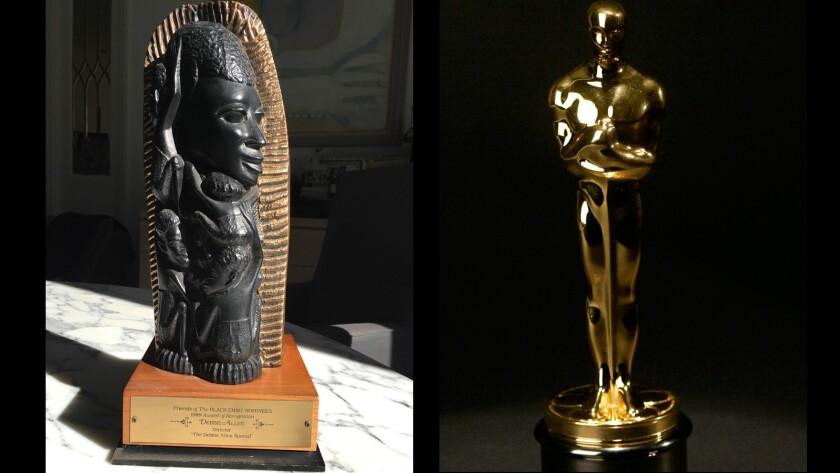 A Tree of Life Award, left, and Oscar statuettes.