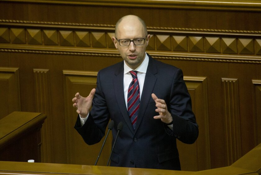 Ukrainian Prime Minister Arseniy Yatsenyuk speaks during the annual report in Parliament in Kiev, Ukraine, Tuesday, Feb. 16, 2016. (AP Photo/Efrem Lukatsky)