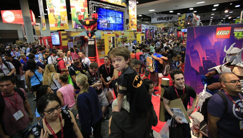 Zak Skelly rides on his father's shoulders through a packed San Diego Convention Center at Comic-Con International on July 23, 2014. The convention will remain in San Diego through 2018.