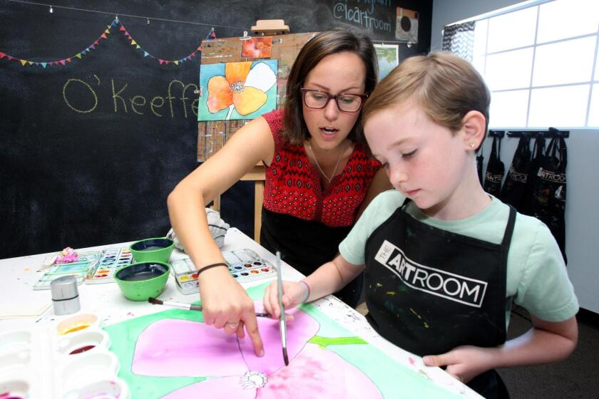 Above, a 9-year-old learns how to create shades with watercolors. Educator Robert Frank writes that taking up art or another hobby is beneficial for people of all ages.