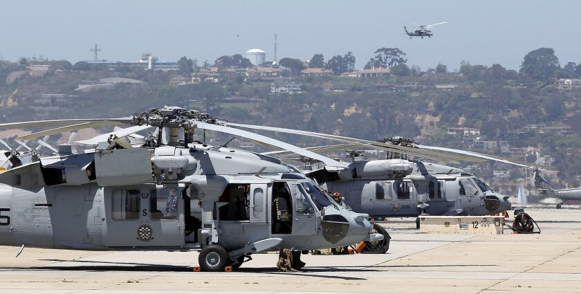 Helicopters squadrons are one thing on the rise in San Diego, amid defense spending cuts. MH-60 Seahawks conduct flight operations from North Island Naval Air Station.