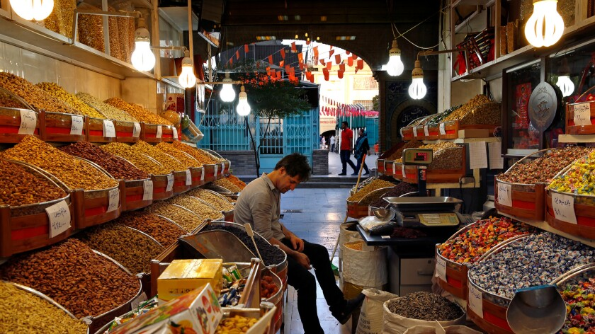 """""""The government was not ill-intentioned,"""" said Ali Rezaei, 36, co-owner of a dried-fruit shop at the Grand Bazaar."""