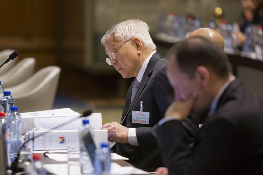 In this Nov. 24, 2015, image provided by the Permanent Court of Arbitration, former Philippine Foreign Secretary Albert del Rosario, who spearheaded the filing of the complaint against China, attends the hearing regarding the Philippines and China on the South China Sea at the Permanent Court of Arbitration (PCA) at The Hague, the Netherlands. A landmark ruling on an arbitration case filed by the Philippines that seeks to strike down China's expansive territorial claims in the South China Sea will be a test for international law and world powers. China, which demands one-on-one talks to resolve the disputes, has boycotted the case and vowed to ignore the verdict, which will be handed down Tuesday, July 12, 2016, by the U.N. tribunal in The Hague. (Permanent Court of Arbitration via AP)