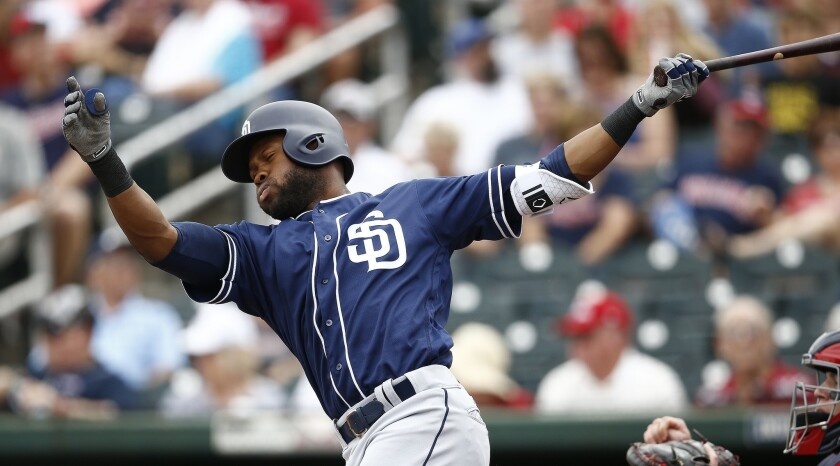 San Diego Padres' Manuel Margot follows through on a swing during the first inning of a spring train