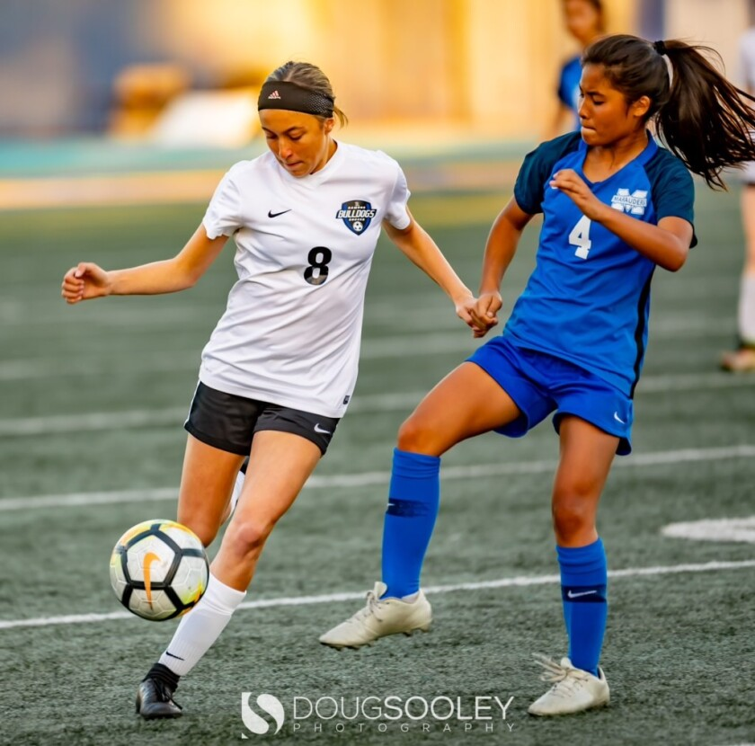 Bulldogs girls soccer player sophomore Georgia Goldstein, number 8, in action.