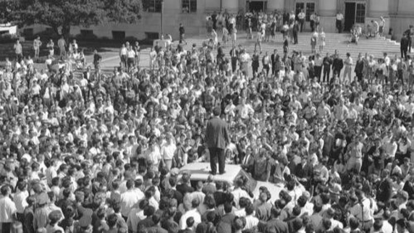 Activist Mario Savio stands atop a police car in front of Sproul Hall at UC Berkeley in 1964. As a faculty member, Glazer was appalled by the student Free Speech Movement.
