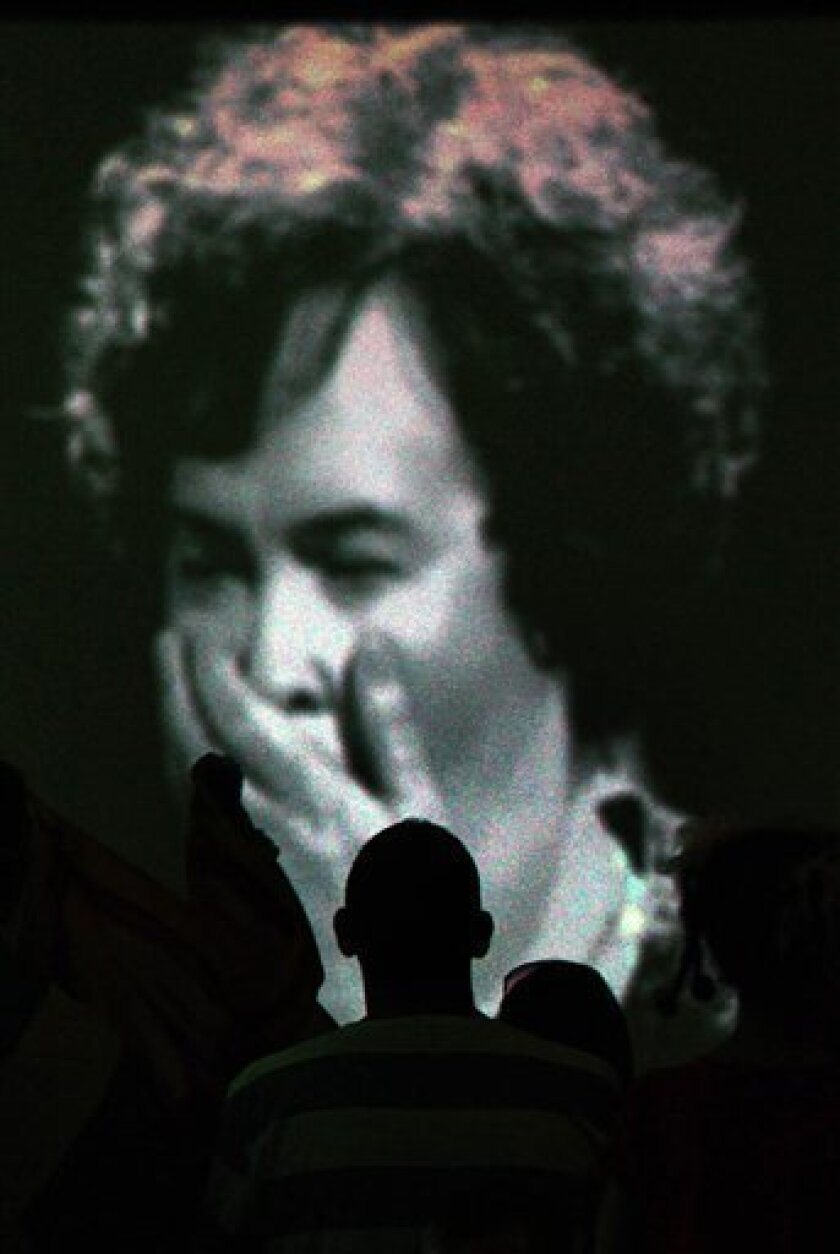 """Locals gather at Blackburn, Scotland, community center to watch Susan Boyle on TV during the final of """"Britain's Got Talent"""" on Saturday May 30, 2009. (AP Photo/PA, David Cheskin)"""