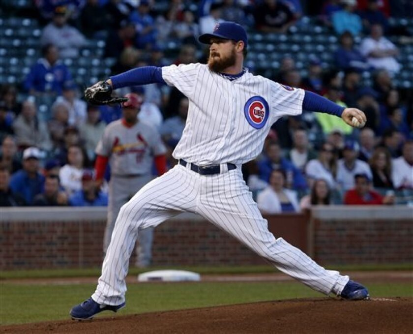 Chicago Cubs starting pitcher Travis Wood delivers during the first inning of a baseball game against the St. Louis Cardinals, Tuesday, May 7, 2013, in Chicago. (AP Photo/Charles Rex Arbogast)