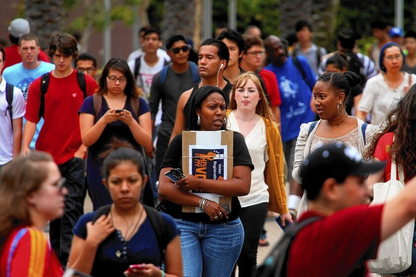 Students walk to class at Santa Monica College. Santa Monica sent 783 students to UC campuses last year, by far the most of 112 community colleges in the state.