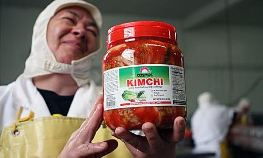 ALL DONE: Factory manager Teresa Guerrero displays a jar of the finished product.