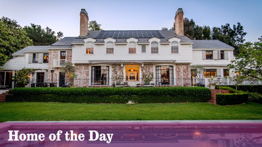 Built in the late 1930s for actress Virginia Bruce and screenwriter J. Walter Ruben, the renovated Traditional-style home features contemporary updates and the original hidden pub room.