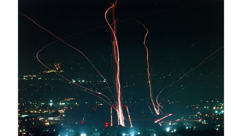 July 10, 1997: The lights of incoming and outgoing planes at Van Nuys Airport leave streaks of light in the night sky.