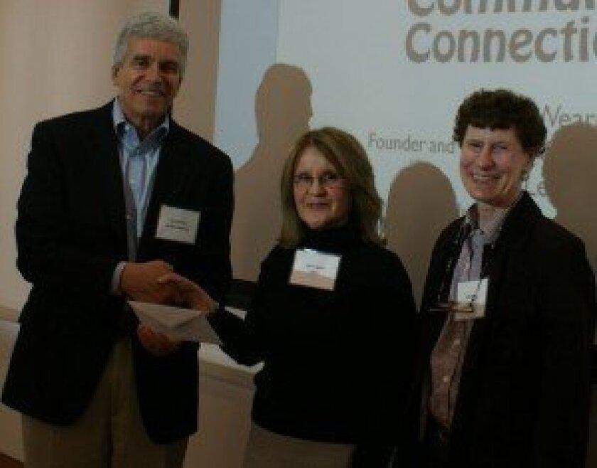 Donald Ambrose, president of Del Mar Healthcare Inc., presents a $15,000 grant award to Nancy Weare, center, and Beth Levine, representatives of Del Mar Community Connections.