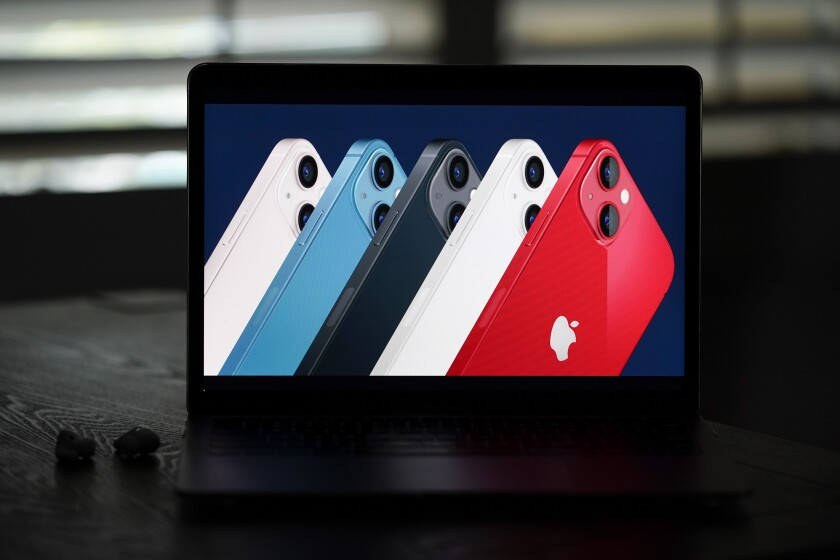 New iPhone 13 smartphones in different colors lined up on the screen of a mobile device.