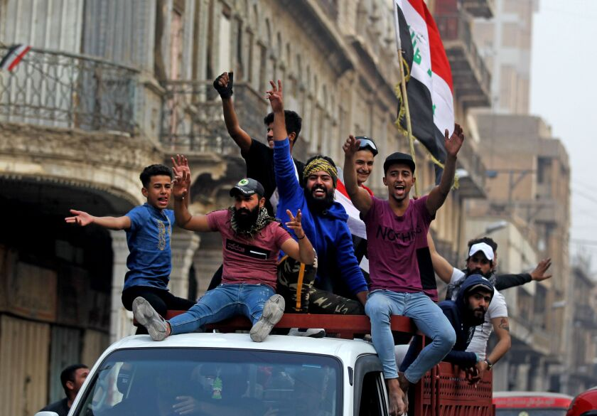 Iraqi demonstrators celebrate resignation of Prime Minister Adel Abdul Mahdi