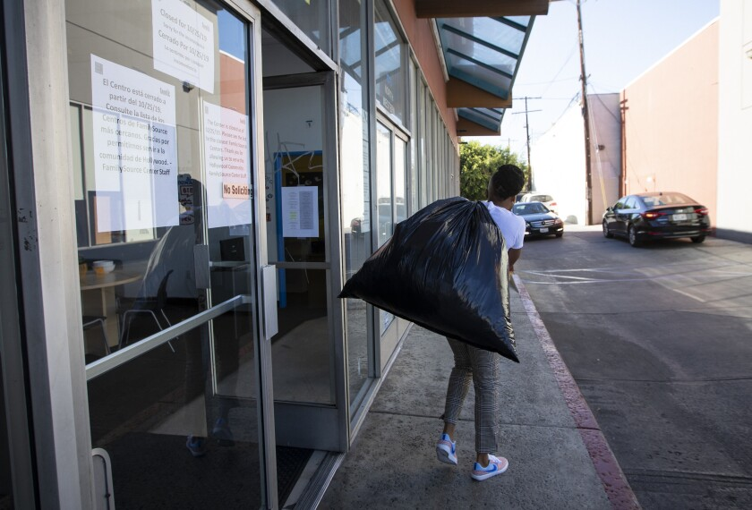 A staff member carries belonging out of the offices of the Youth Policy Institute on the day it closed.