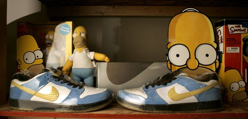 Nike shoes inspired by the animated character Homer Simpson on display inside Jordan Geller's ShoeZeum. The shoes were only released in Australia.