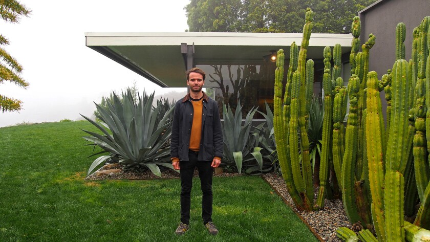 Artist Yan Tomaszewski in front of La Crescenta's Serulnic residence, designed by Richard Neutra. (Roy Dowell)
